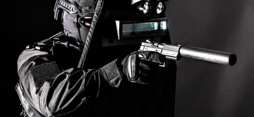 man in black holding a gun