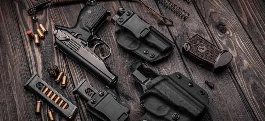Gun accessories in wooden background