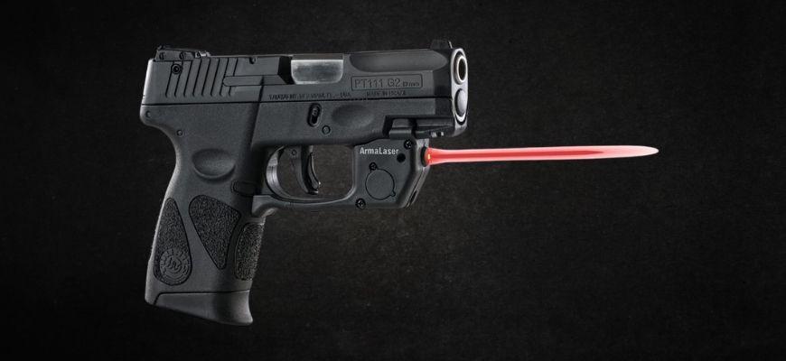 Taurus G2C with laser in black background