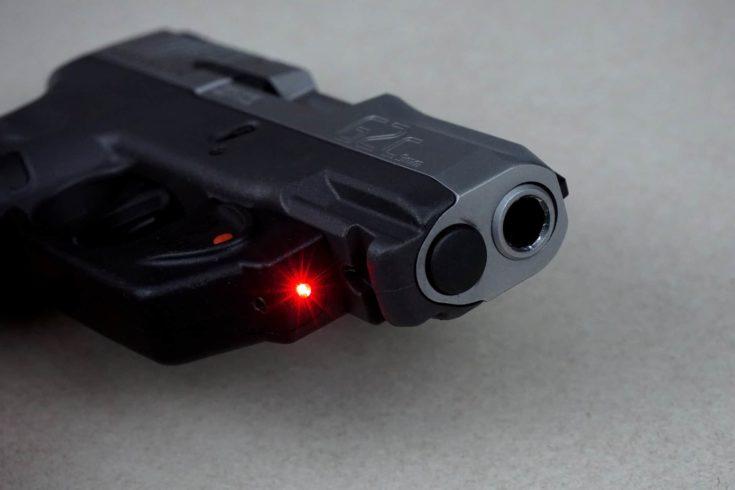 Handgun with red laser light