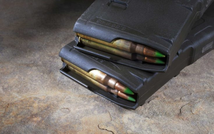 Two magazines that hold thirty rounds for a modern sporting rifle