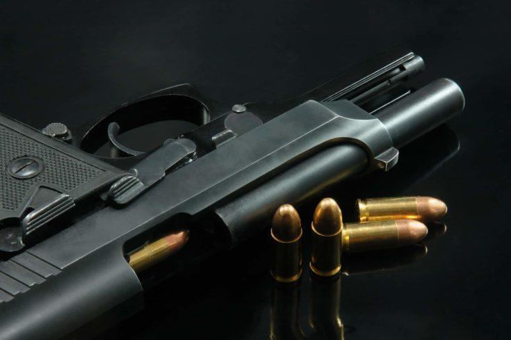 Black gun and bullets