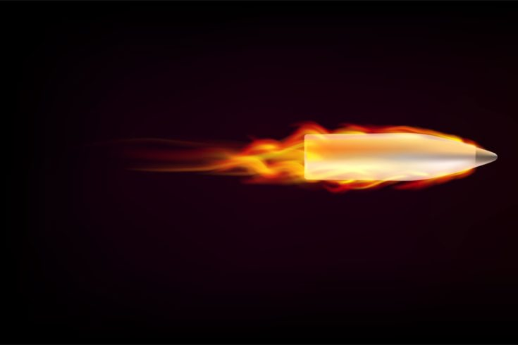 Flying bullet with red tongues of flame on a dark background. Bullet in flame