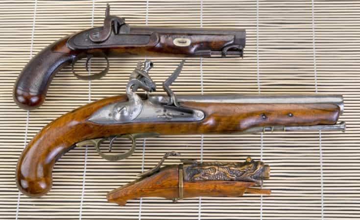 Real Antique pistols, 19th century English percussion,18th century English flintlock and 19th century Chinese matchlock pistol.