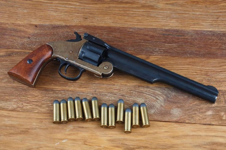 .44 smith and wesson single action revolver isolated on wooden background