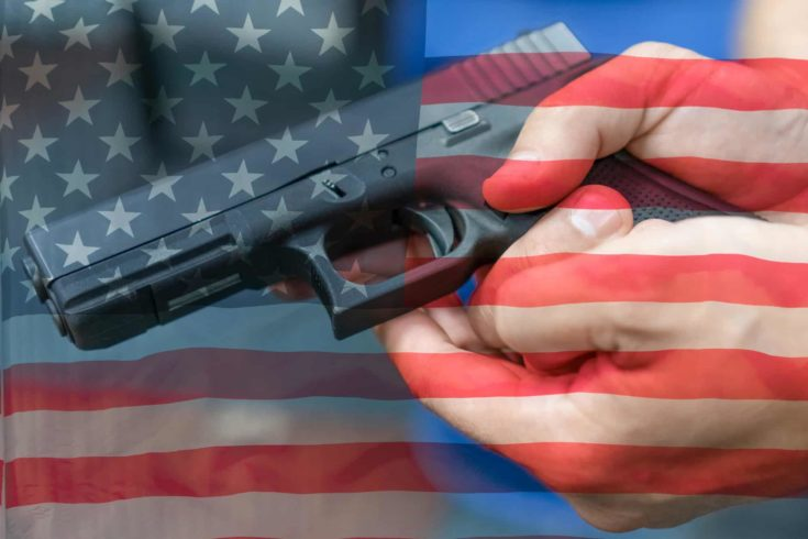 United States Gun Laws - Guns and weapons. A hand of man practicing firing using a Glock gun model at the shooting range. Fire glock hand gun on the background of the american flag.