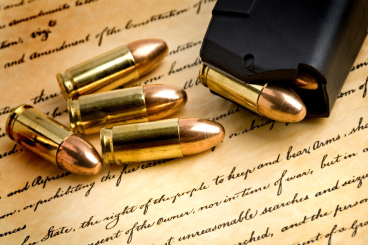 bullets and modern loaded 9mm clip over the bill of rights, focus on the right of the people to keep and bear arms