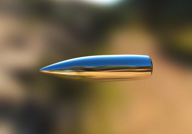 Macro shot of silver bullet caught in flight