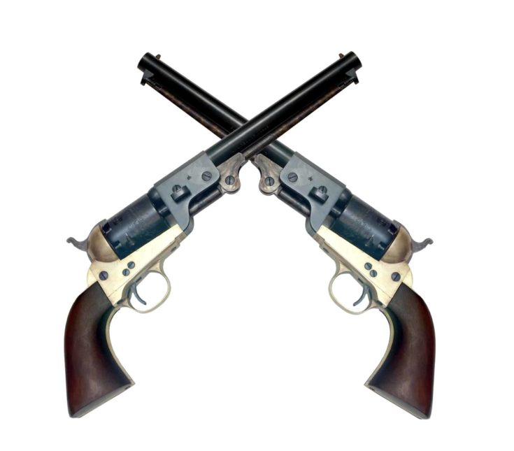 Two old metal colt revolver on white background