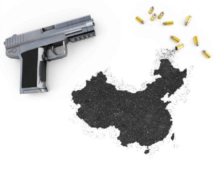 Gunpowder forming the shape of China and a handgun.(series)