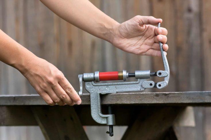 reloading cartridge by shotgun shell reloader, closeup