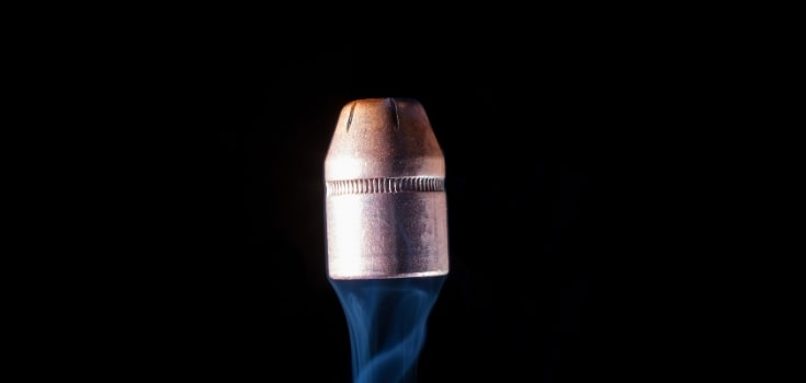 Semi wadcutter bullet with smoke isolated on black