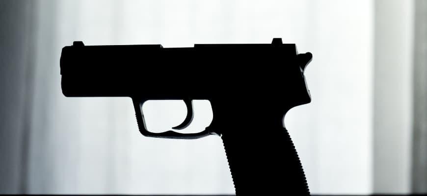 Black gun in gray to white background