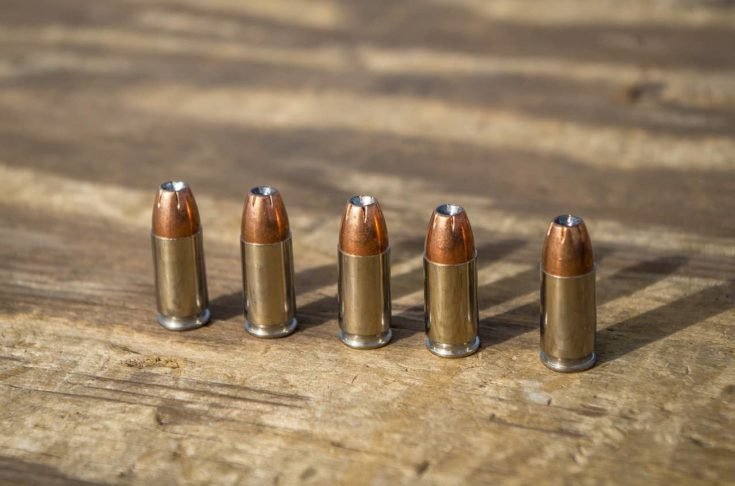 Hollow point semi jacketed bullets on a wooden table