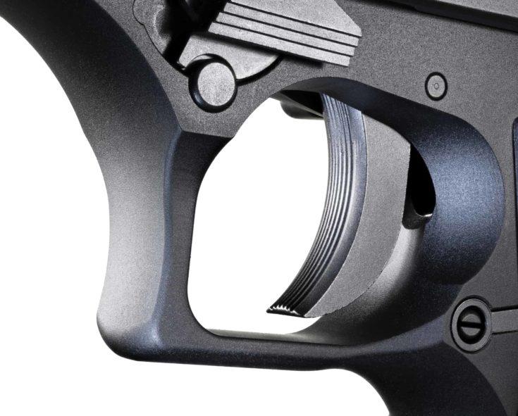 White behind a trigger on a semi automatic handgun