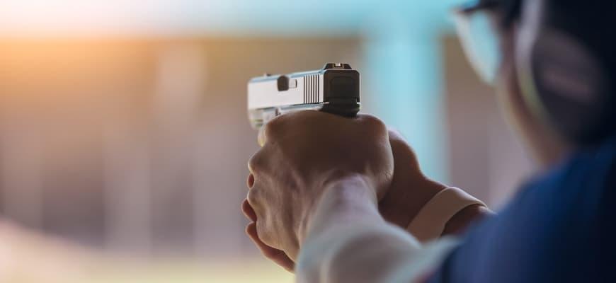 Man holding a handgun.