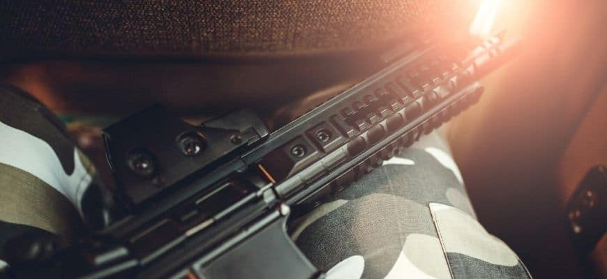 Focus image of rifle on soldier's lap
