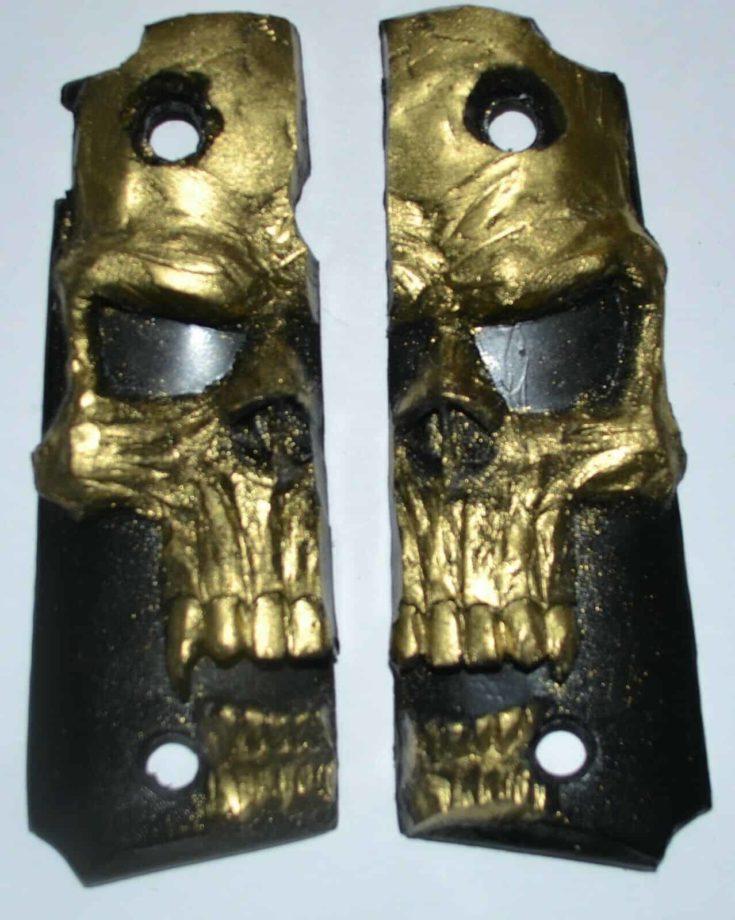 Taurus PT1911 pistol grips gold skull on black plastic