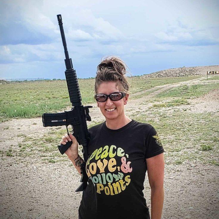 Danielle Mcleod holding a gun