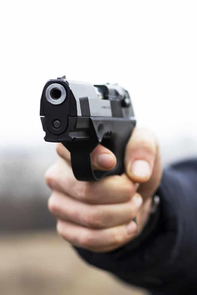 Gun in hand closeup