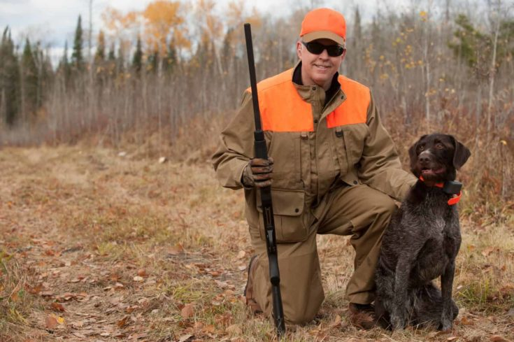 Hunter with favorite pointer during a grouse hunt in northern Minnesota.