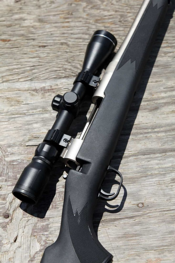 Black rifle on wooden backgroundBlack rifle on wooden background