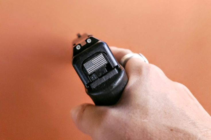 holding a PG Glock 31 in the hand