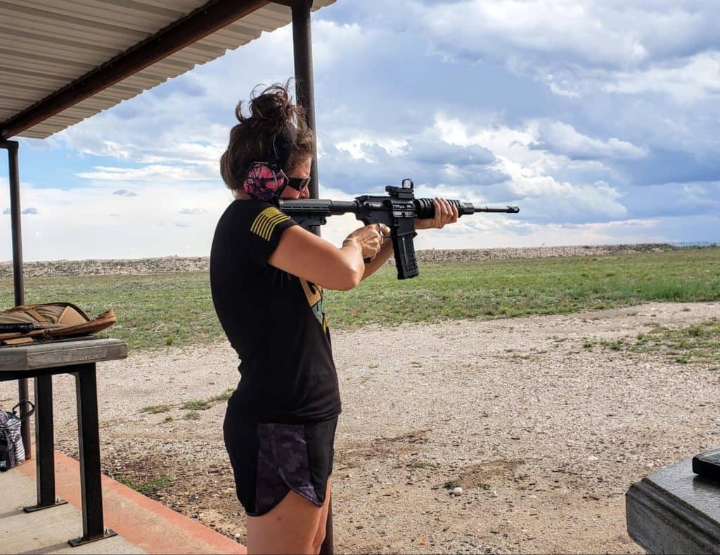 Woman using truglo red dot sight
