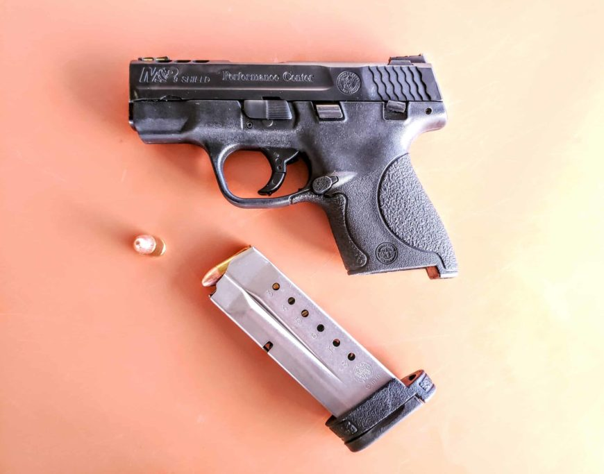 A picture of Smith and Wesson M&P Shield with a magazine and a bullet