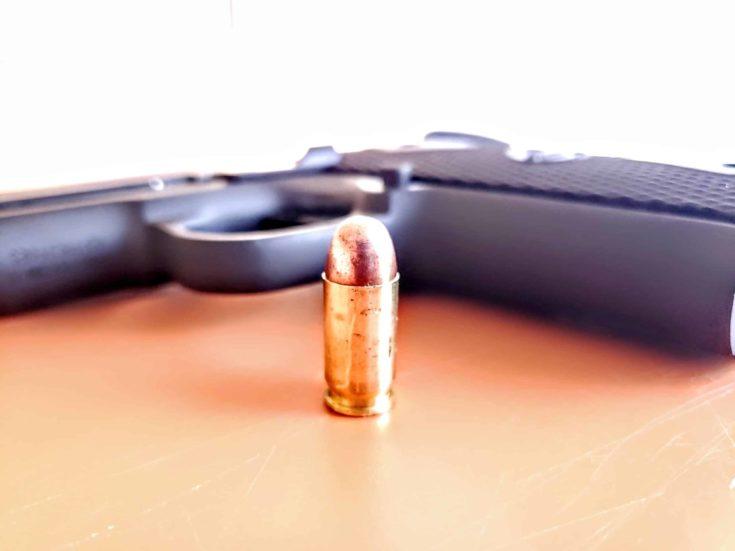 PG Baby Rock 380 bullet in front of the gun