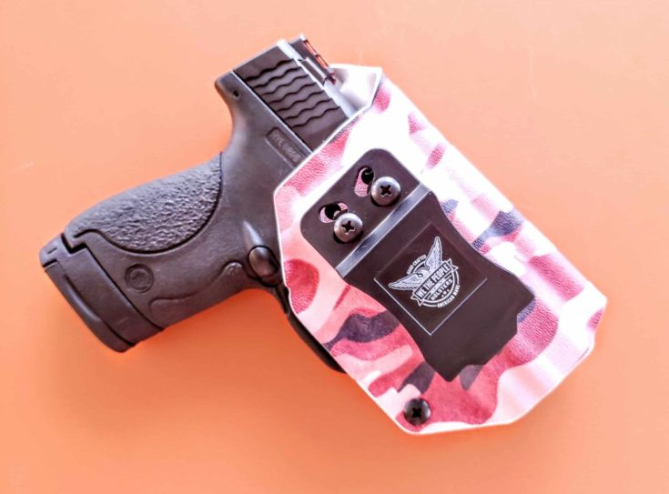 pink camo kydex and a Gun holstered