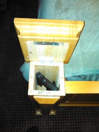 Hidden bed storage for guns