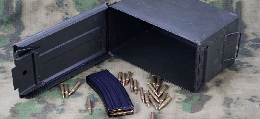 Ammo Can with ammo on camouflage background