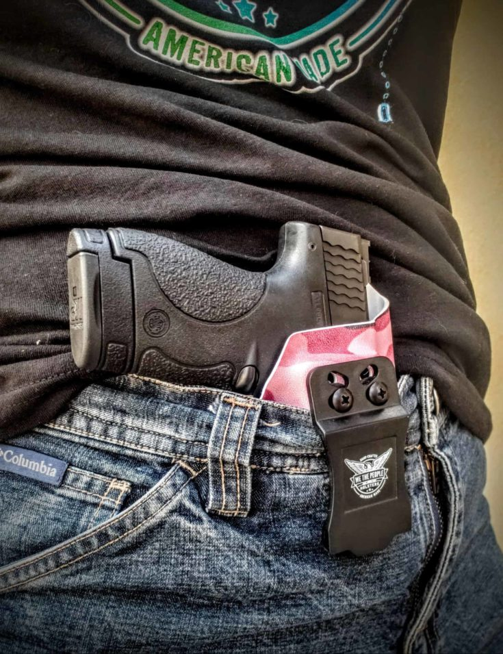 focus view on a gun and we the people holsters