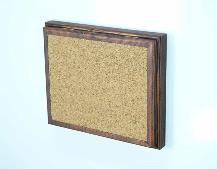 message board with a hidden compartment