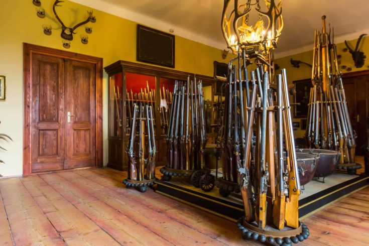 Room with old weapons, ancient armory storage, Europe. Medieval european guns
