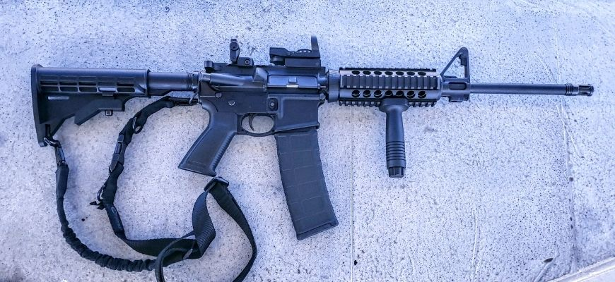 an image of ruger ar-556 with a strap