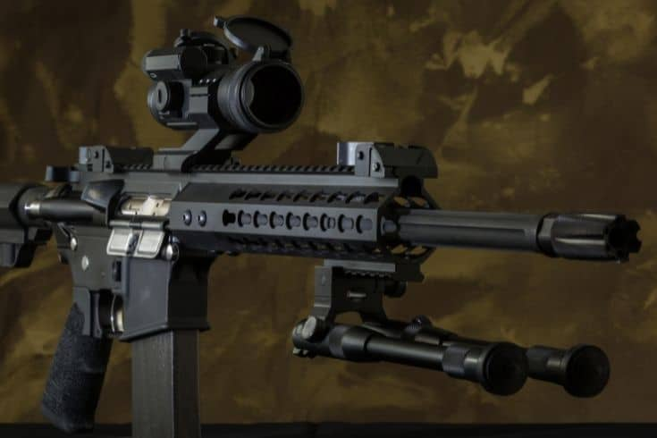 300 blackout ar style rifle in a camo background
