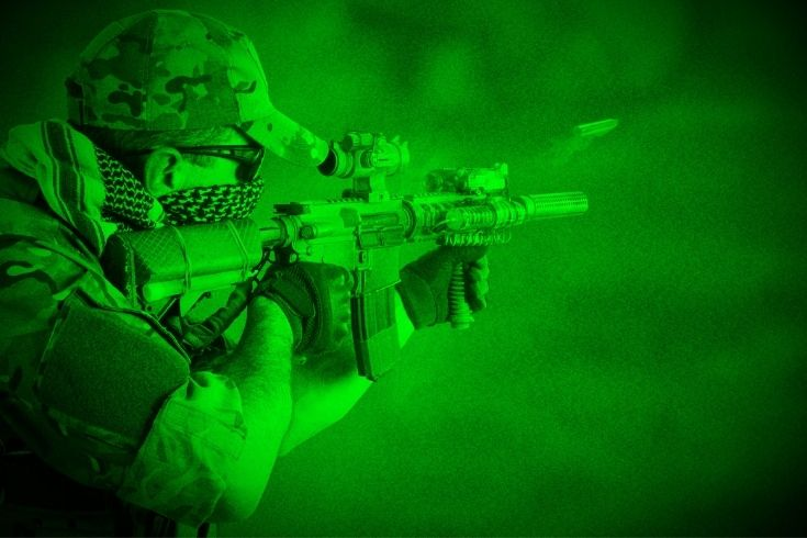 Private Military Company operator with assault rifle. View through night vision